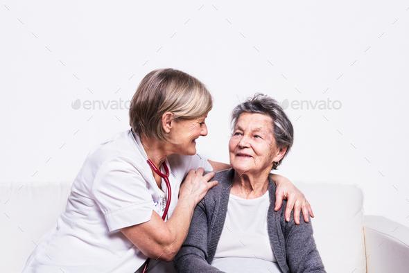 Studio portrait of a senior nurse and an elderly woman. - Stock Photo - Images