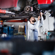 Man mechanic repairing a car in a garage. - PhotoDune Item for Sale