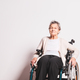 Portrait of a senior woman with wheelchair in studio. - PhotoDune Item for Sale