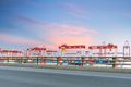 container terminal with highway against a sunset glow sky  - PhotoDune Item for Sale