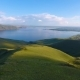 Aerial View of the Green Hills, Cloudy Sky and the Yenisei River - VideoHive Item for Sale