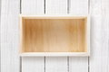 Wooden box on white wooden background - PhotoDune Item for Sale
