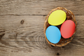 Easter eggs on wooden table top view - PhotoDune Item for Sale