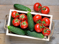 Cucumbers and tomatoes in wooden box top view - PhotoDune Item for Sale