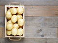 Potatoes in wooden box on table top view - PhotoDune Item for Sale