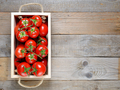 Tomatoes in wooden box on table top view - PhotoDune Item for Sale