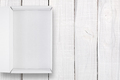 Opened white box with cover on white wooden background top view - PhotoDune Item for Sale