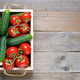 Tomatoes and cucumbers in wooden box top view - PhotoDune Item for Sale