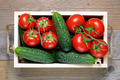 Tomatoes and cucumbers in wooden box close-up - PhotoDune Item for Sale
