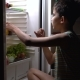 Teenager Sits next to the Fridge and Eats Food - VideoHive Item for Sale