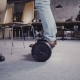 Camera Follows Male Legs on Hoverboard in Modern Office. Young Businessman Using Segway To Move - VideoHive Item for Sale