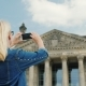 A Woman Tourist Takes Pictures of the Building of the Bundestag in Berlin. Tourism in Germany and - VideoHive Item for Sale