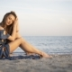 Young Attractive Cheerful Girl Sitting on the Beach - VideoHive Item for Sale