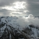 Flying in Clouds Between Snow-capped Mountains - VideoHive Item for Sale