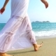 Girl in White Dress Walking on the Sand Beach on Sunny Day - VideoHive Item for Sale