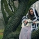 Caucasian Teen Girl Playing Guitar Sitting on a Tree in Fairytale Forest - VideoHive Item for Sale
