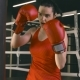 Young Woman in Boxing Gloves Hitting a Boxing Bag - VideoHive Item for Sale