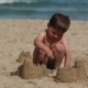 Boy Is Building a Sand Castles on the Beach - VideoHive Item for Sale