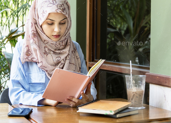 Islamic woman reading book - Stock Photo - Images