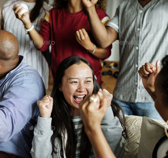 Friends cheering sport league together - Stock Photo - Images