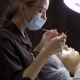 Beautician Makes Procedure of Eyelash Extension in Beauty Salon