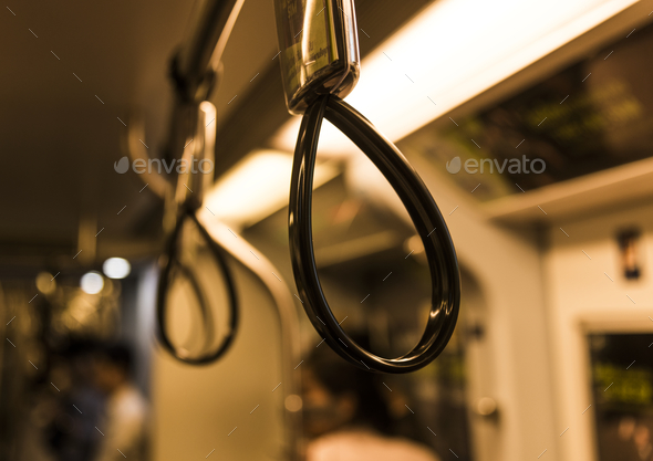 Closeup of handle in public transportation - Stock Photo - Images