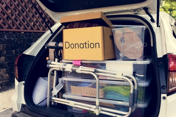 Donations in the back of a car - Stock Photo - Images