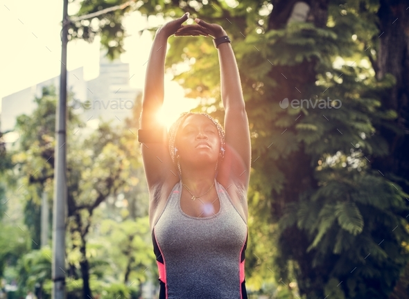 A woman exercising in the park - Stock Photo - Images