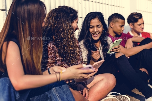 Group of young teenager friends chilling out together using smartphone social media concept - Stock Photo - Images