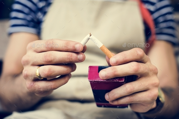 Smoker quitting the cigarette - Stock Photo - Images