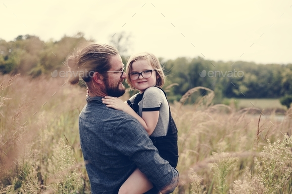Father and daughter enjoying their time together - Stock Photo - Images