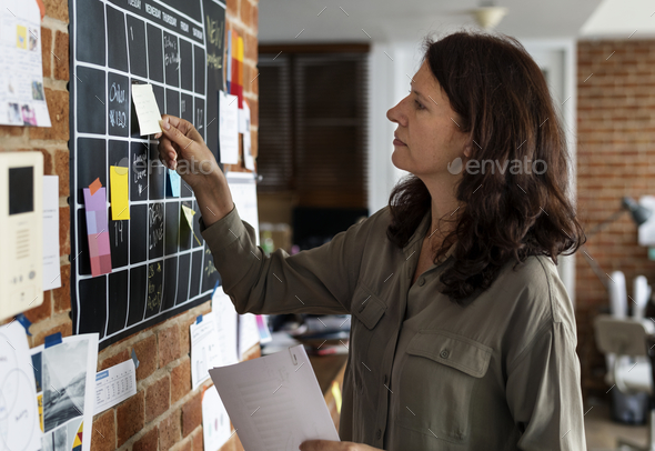 Woman pulling sticky note - Stock Photo - Images