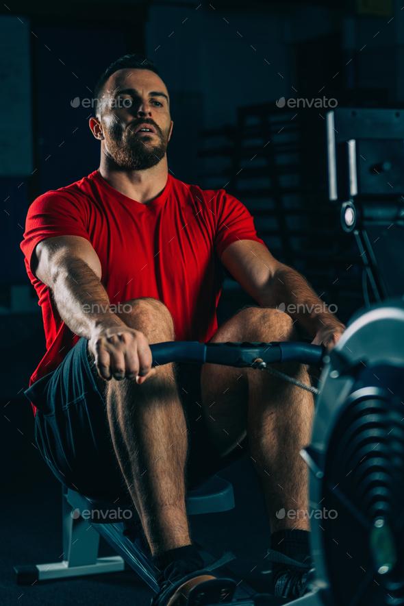 Cross training. Rowing machine exercising - Stock Photo - Images