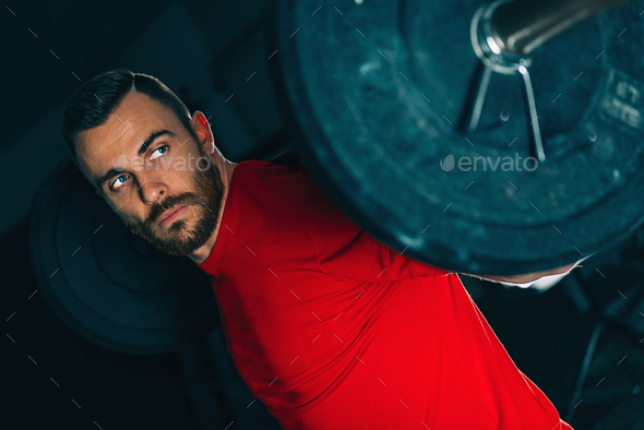 Cross training. Male athlete lifting weights - Stock Photo - Images