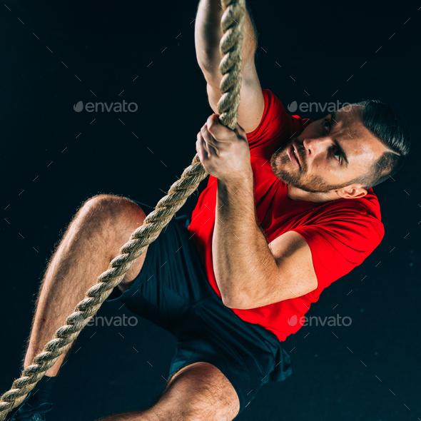 Cross training. Rope climbing exercise - Stock Photo - Images