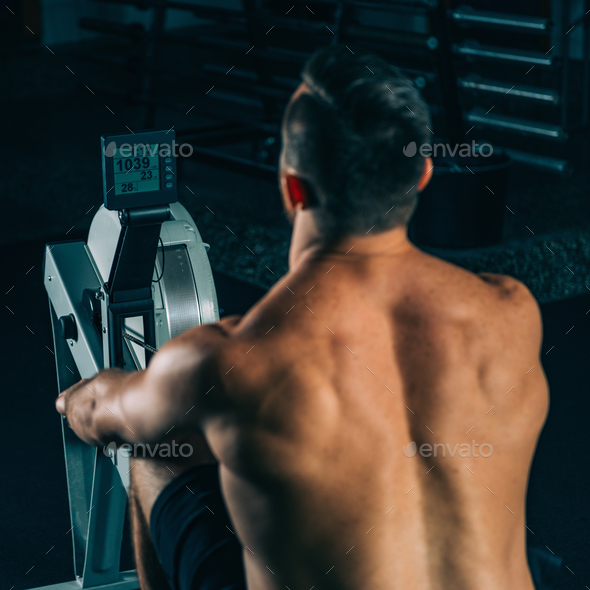 Cross training. Rowing machine exercising - Stock Photo - Images
