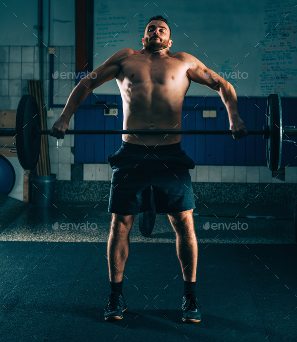 Cross training. Male athlete lifting heavy barbells - Stock Photo - Images