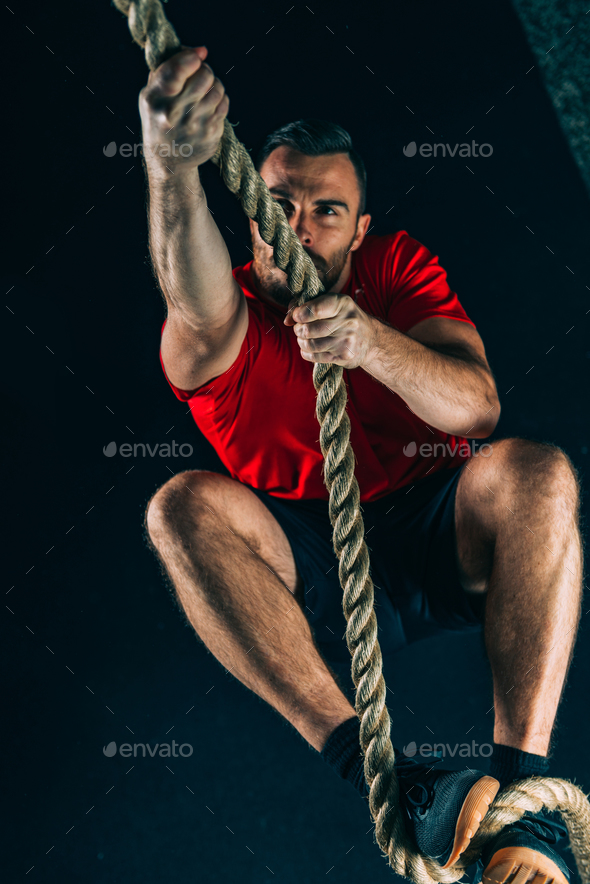 Cross training. Rope climbing exercise - Stock Photo - Images