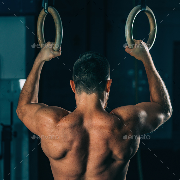 Cross training. Gymnastic rings exercising - Stock Photo - Images