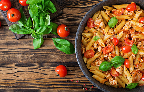 Penne pasta in tomato sauce with chicken - Stock Photo - Images