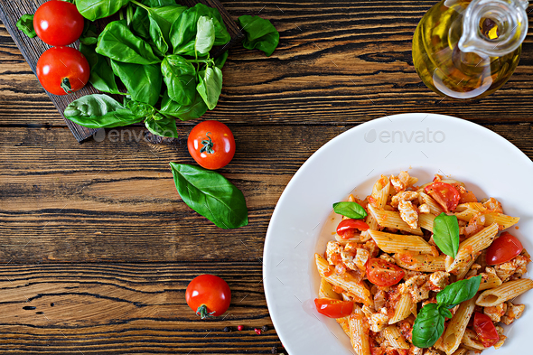 Penne pasta in tomato sauce with chicken, - Stock Photo - Images