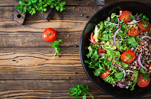 Buckwheat salad with cherry tomatoes, red onion and fresh herbs. - Stock Photo - Images