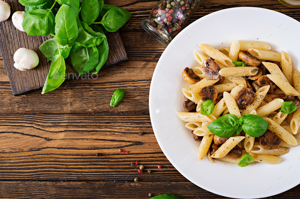 Vegetarian Vegetable pasta penne  with mushrooms - Stock Photo - Images