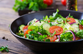Salad from tomatoes, cucumber, red onions and lettuce leaves. - PhotoDune Item for Sale