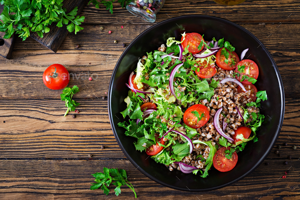 Buckwheat salad with cherry tomatoes, red onion and fresh herbs - Stock Photo - Images