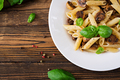 Vegetarian Vegetable pasta penne  with mushrooms  in white bowl on wooden table - PhotoDune Item for Sale