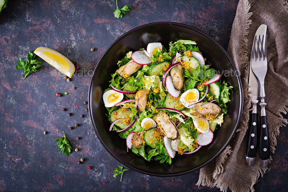 Dietary salad with mussels, quail eggs, cucumbers, radish and lettuce. - Stock Photo - Images