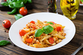Penne pasta in tomato sauce with chicken, tomatoes, decorated with basil on a wooden table. - PhotoDune Item for Sale
