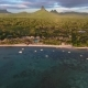 Aerial View of Mauritius coastline,Rempart Mountain, Forested Landscape. Foamy Waves Come To Coast - VideoHive Item for Sale