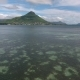 Aerial Low Flying Over Lagoon with Foamy Waves Creating on the Boarder with Indian Ocean, Moving - VideoHive Item for Sale